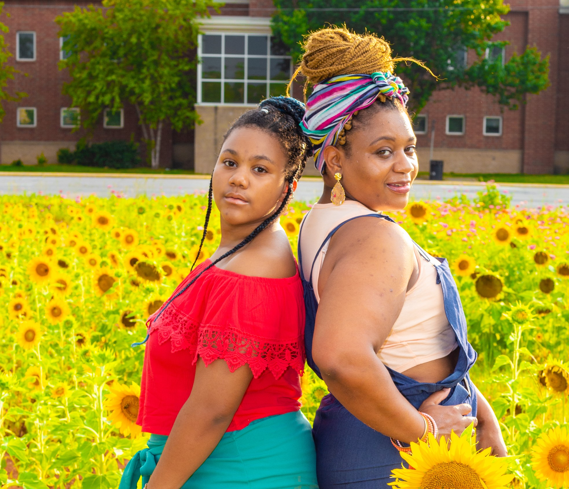 Kayla Mallet and her daughter, Rissy in a field of sunflowers